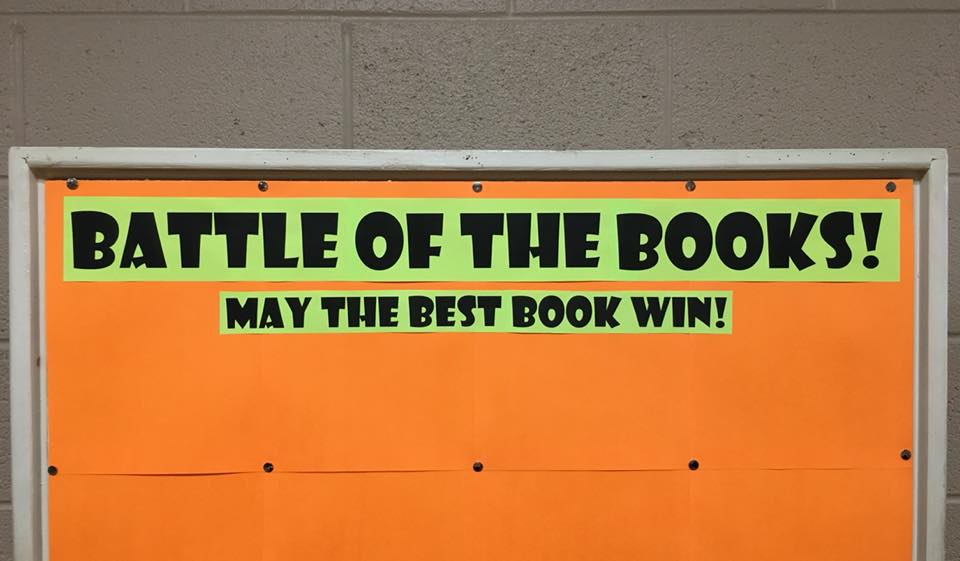 A display that reads: Battle of the Books, may the best book win!