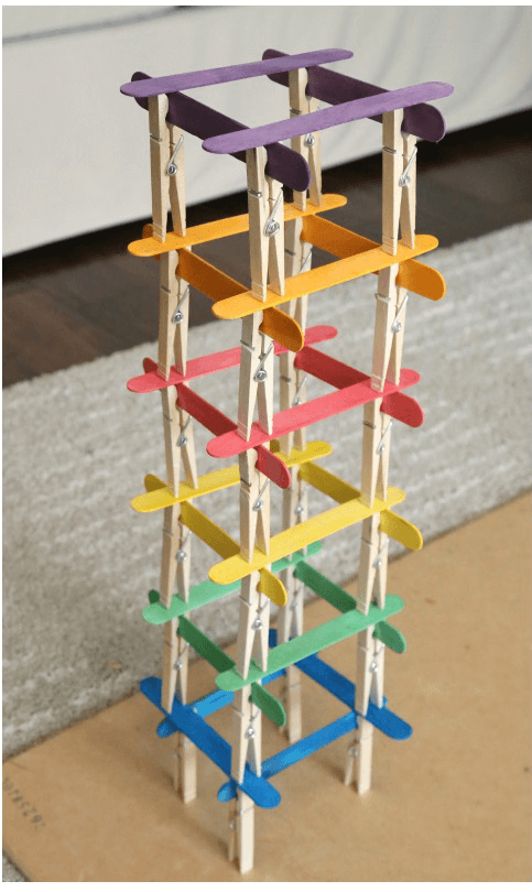 A tower built from colorful craft sticks and clothespins.