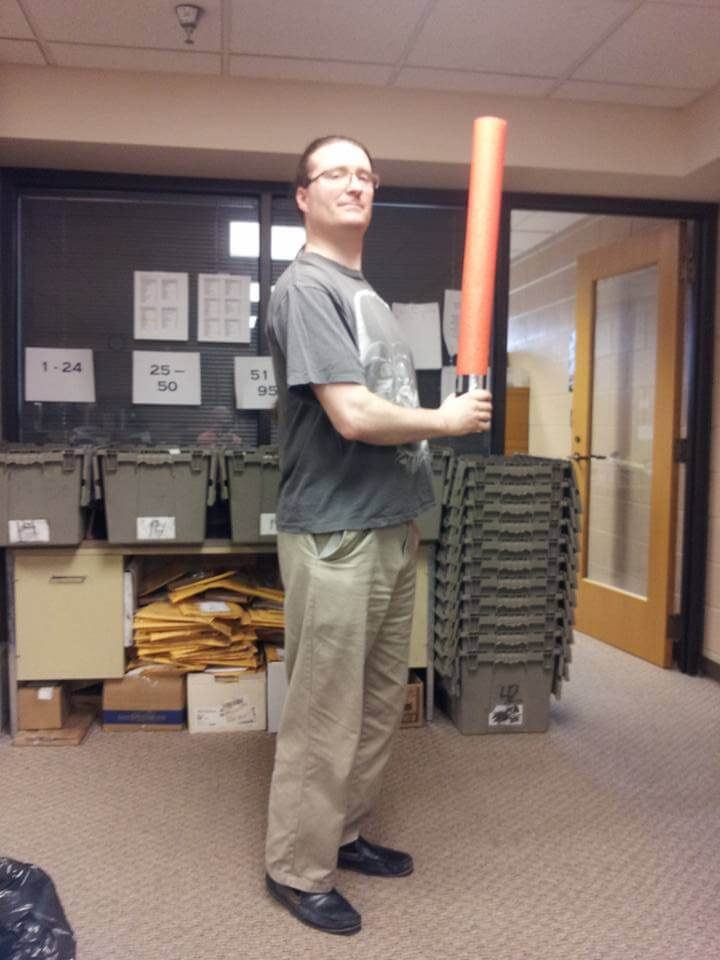 Librarian Mike weilding a pool-noodle saber